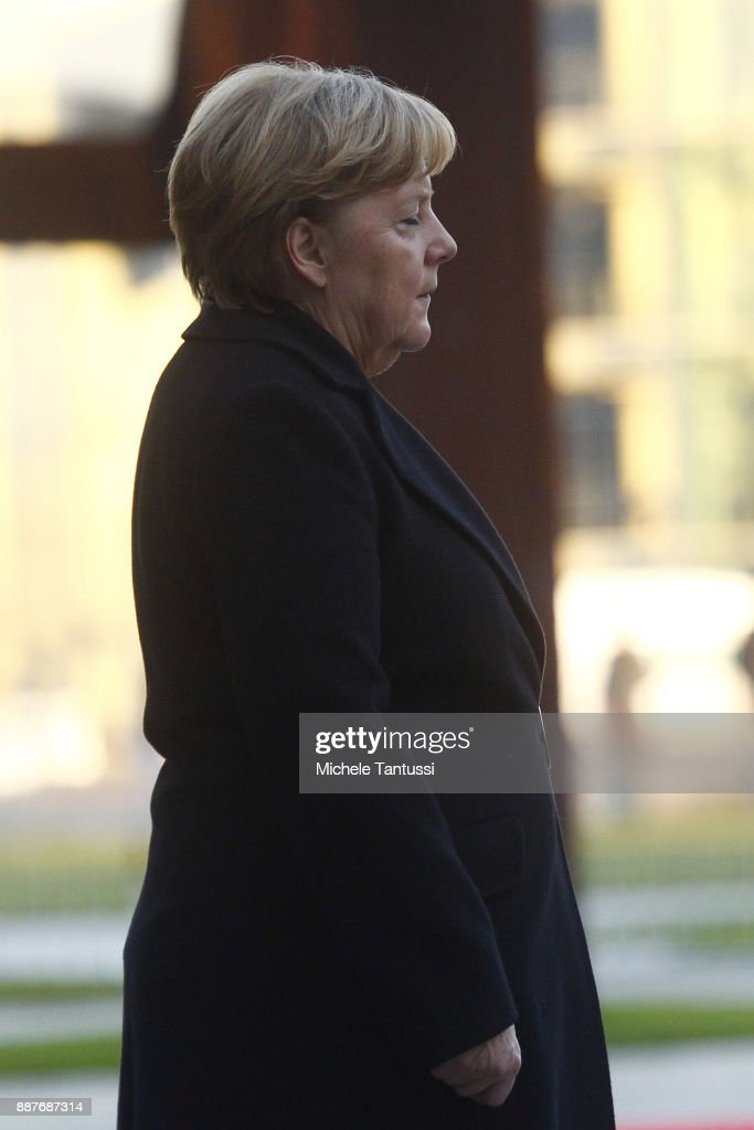 Germany Chancellor Angela Merkel waits for Chairman of the Presidential Council of Libya and Prime Minister in the Courtyard of the German Chancellery ahead of their meeting on December 7, 2017 in Berlin, Germany. The Libyan leader meets Merkel to discuss the political situation of both states relationship, focusing on finding a better way to solve the refugees issue.