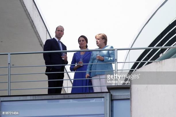 Germany Chancellor Angela Merkel welcomes Catherine Duchess of Cambridge and Prince William Duke of Cambridge on the balcony of the german...