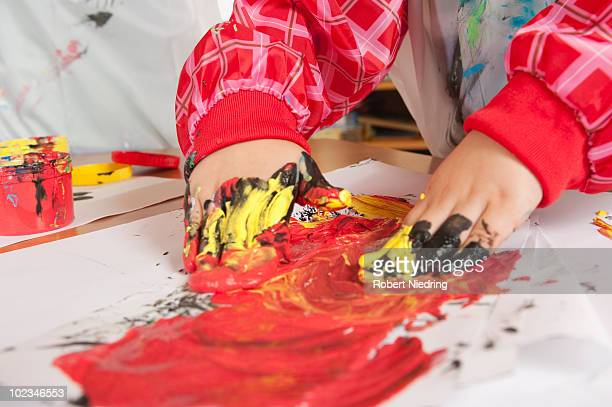 Germany, Child painting with hands, close-up
