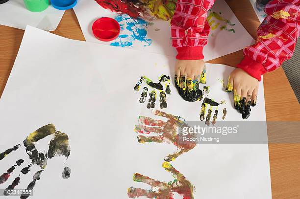 Germany, Child painting with hands, elevated view