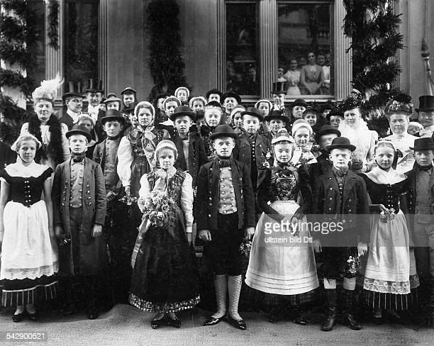 Germany children dressed in traditional costumes welcoming of the young grand duke Friedrich Franz IV of Mecklenburg Schwerin date unknown probably...