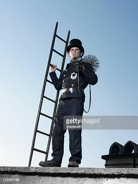 germany, chimney sweep with broom and ladder - schornsteinfeger stock-fotos und bilder