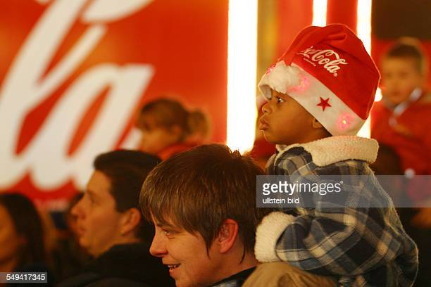 GER Germany Christmas market Coca Cola truck little Child