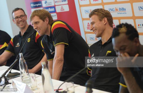 Germany coach Chris Fleming and players Dirk Nowitzki Heiko Schaffartzik and Dennis Schroeder at a Q and A session at the beginning of a press...
