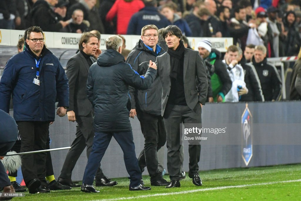 Germany coach Joachim Low and France coach Didier Deschamps shake hands at the end of the international friendly match between Germany and France at RheinEnergieStadion on November 14, 2017 in Cologne, Germany.