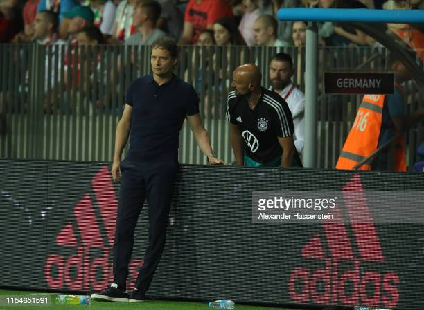 Germany coach Marcus Sorg taks with assistant Toni Di Salvo during the UEFA Euro 2020 qualifier match between Belarus and Germany at BorisovArena on...