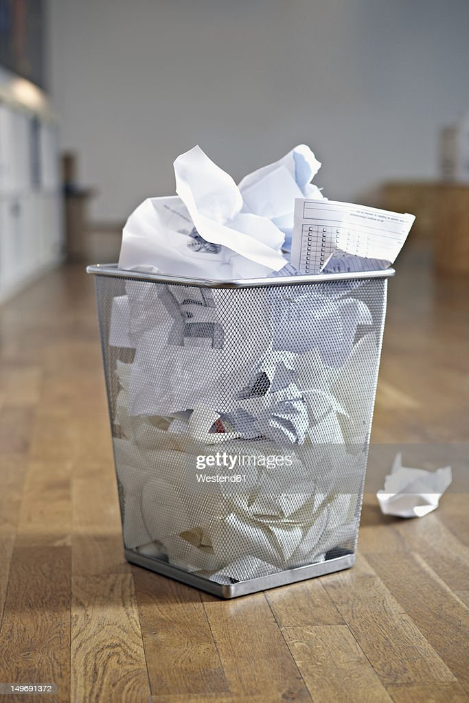 Germany, Cologne, Basket with waste paper in apartment : Stock Photo