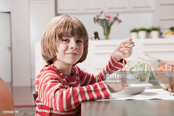 Germany, Cologne, Boy (6-7) eating Spaghetti, portrait, close-up