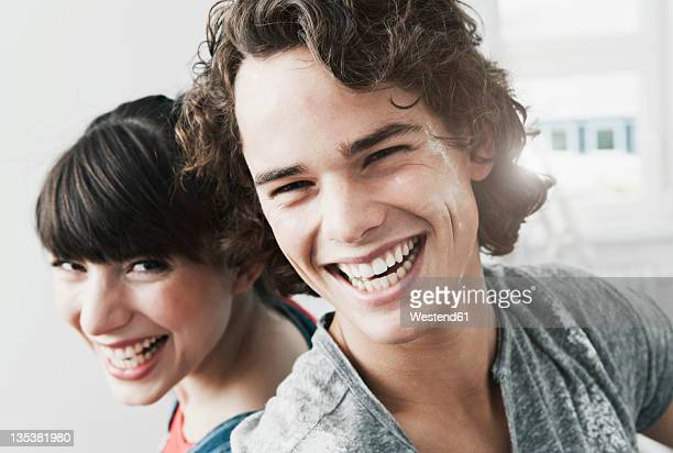 Germany, Cologne, Close up of happy young couple in renovating apartment