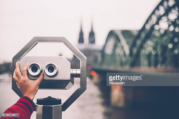 Germany, Cologne, coin operated binoculars in front of Rhine