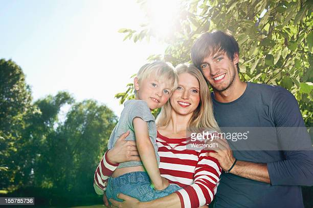 Germany, Cologne, Family smiling, portrait