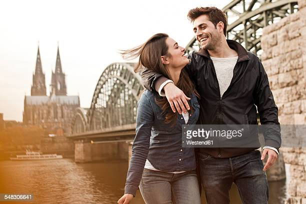 Germany, Cologne, happy young couple on city tour