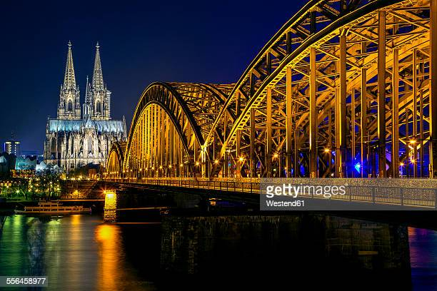 germany, cologne, illuminated cologne cathedral and hohenzollern bridge at night - cologne cathedral stock photos and pictures