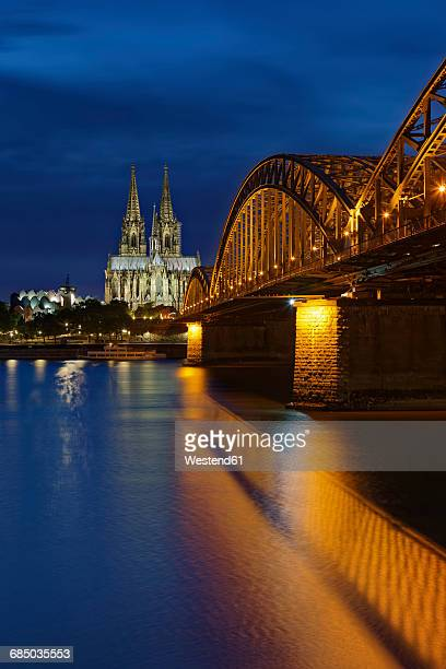 Germany, Cologne, lighted Cologne Cathedral and Hohenzollern Bridge