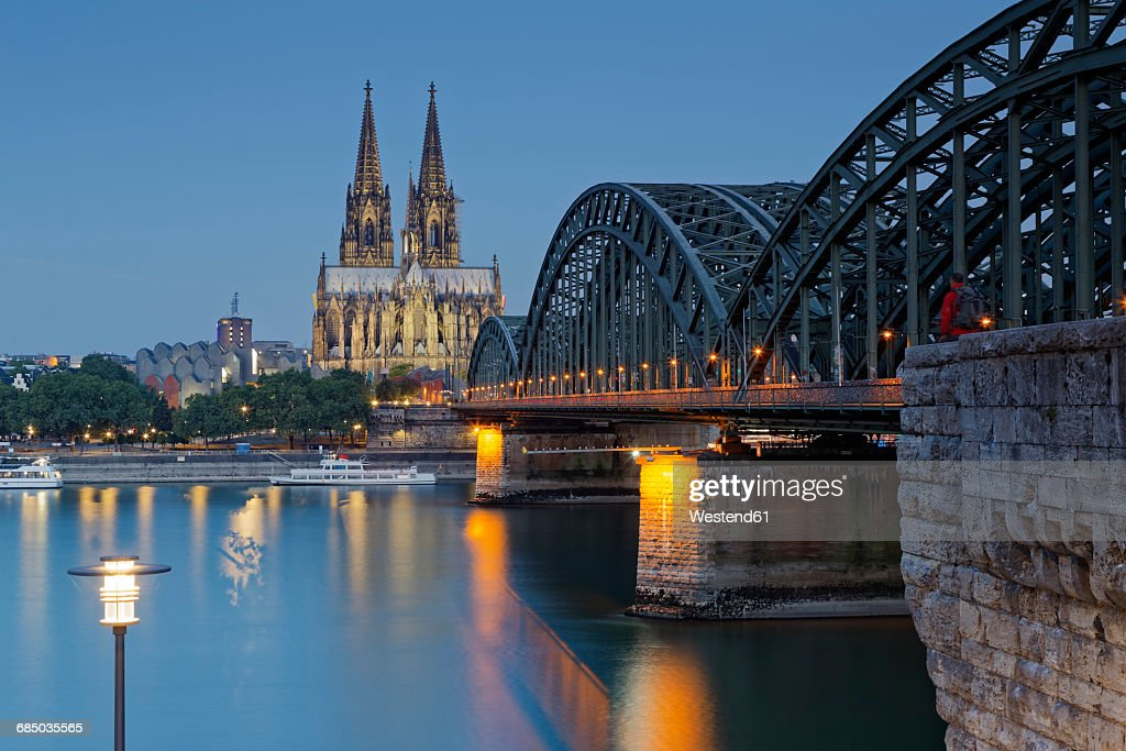 Germany, Cologne, lighted Cologne Cathedral and Hohenzollern Bridge : Stock Photo