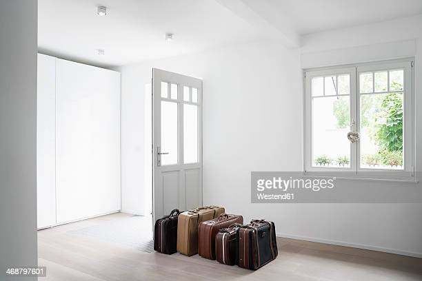 Germany, Cologne, Luggage in empty room