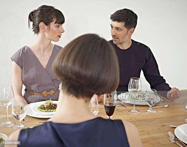 Germany, Cologne, Man and women having dinner
