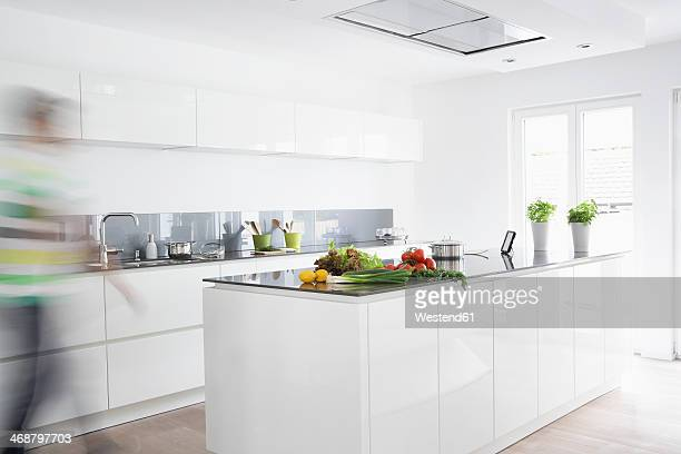 Germany, Cologne, Man in kitchen, blurred motion