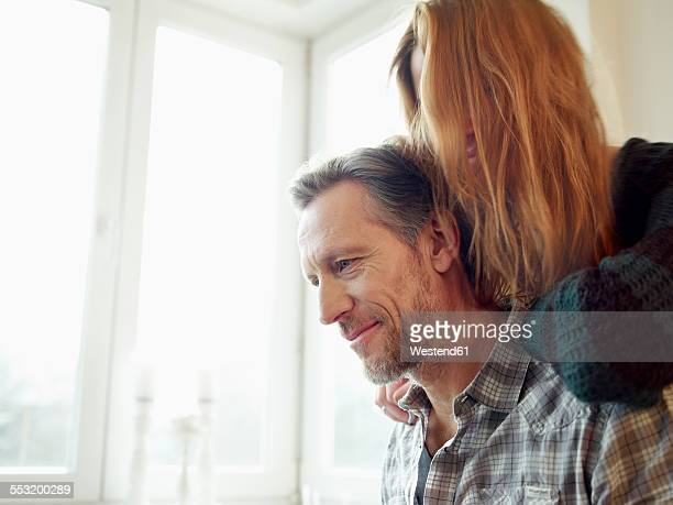 germany, cologne, mature man and young woman with hands on his shoulders - hand on shoulder stock photos and pictures