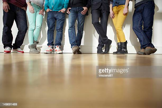 Germany, Cologne, Men and women standing on floor