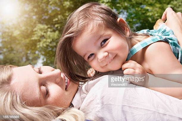 Germany, Cologne, Mother and daughter smiling, close up