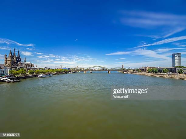 Germany, Cologne, panorama view with Hohenzollern Bridge and Rhine River in the foreground