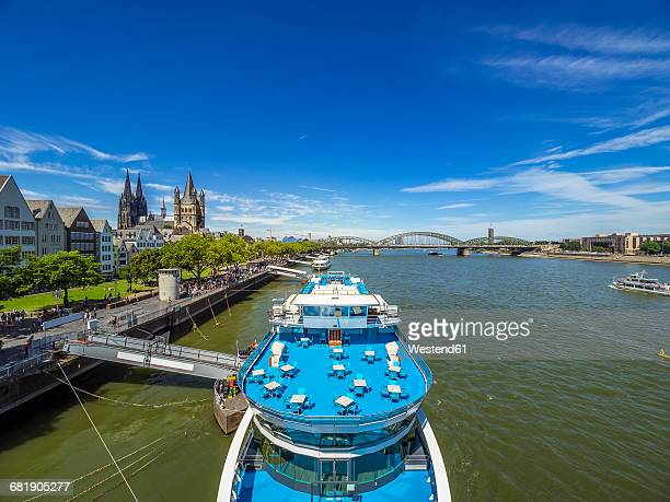 Germany, Cologne, panorma view view with tourboat on Rhine River in the foreground