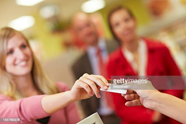 Germany, Cologne, People using credit card in supermarket