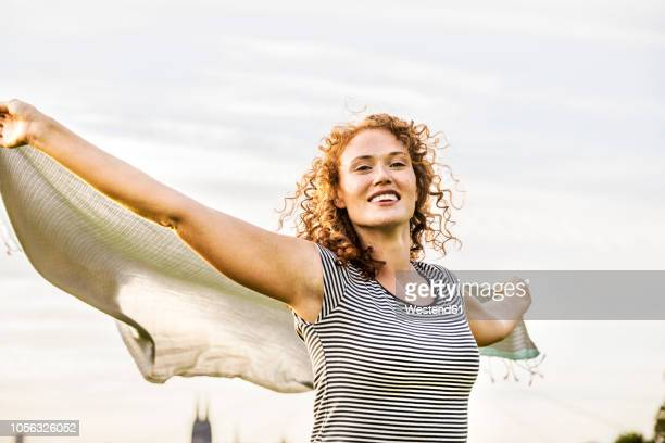 Germany, Cologne, portrait of happy young woman