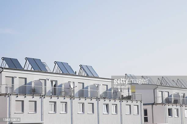 Germany, Cologne, Roof of residential building with solar panels