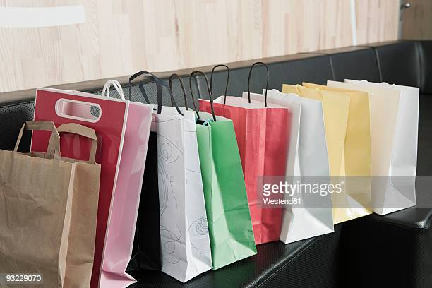 Germany, Cologne, Shopping bags on sofa
