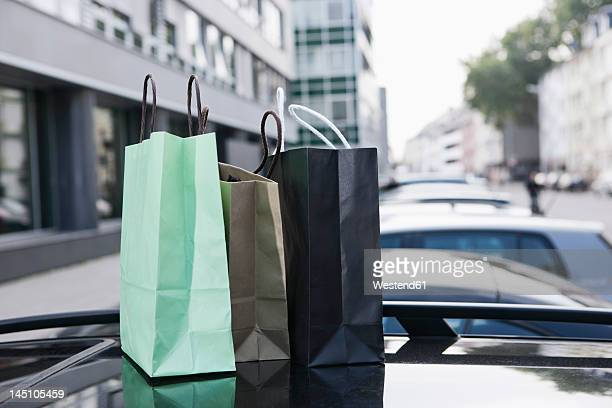 Germany, Cologne, Shopping bags on car roof