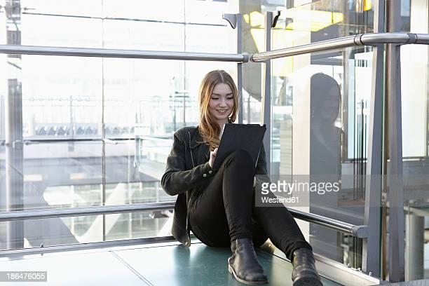 Germany, Cologne, Teenage girl using digital tablet