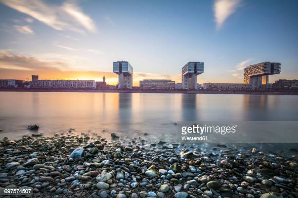 germany, cologne, view to crane houses at dusk - cologne stock pictures, royalty-free photos & images