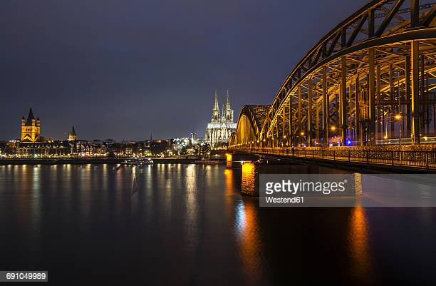 germany, cologne, view to gross sankt martin, cologne cathedral and hohenzollern bridge by night - cologne cathedral stock photos and pictures