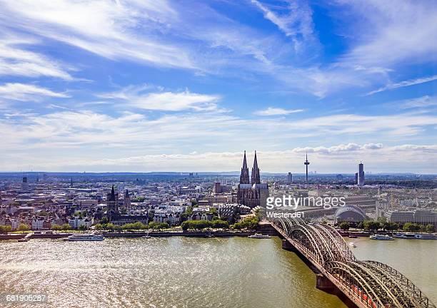 germany, cologne, view to the city with hohenzollern bridge and rhine river in the foreground from above - köln stock-fotos und bilder