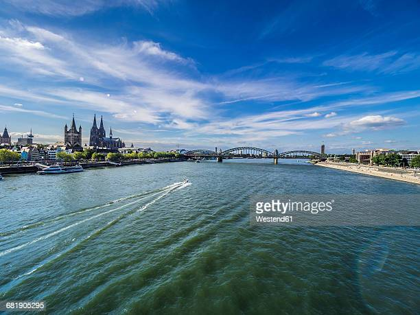 Germany, Cologne, view to the city with Hohenzollern Bridge and Rhine River in the foreground