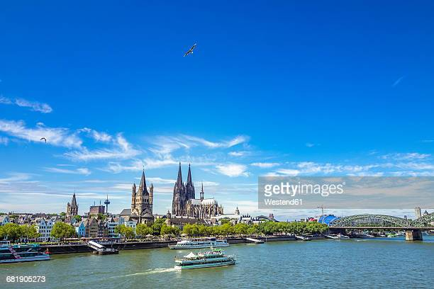 germany, cologne, view to the skyline with rhine river in the foreground - cologne stock pictures, royalty-free photos & images