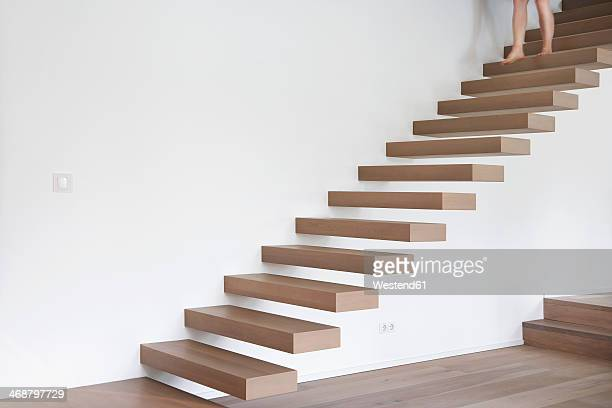 Germany, Cologne, Woman on stairs