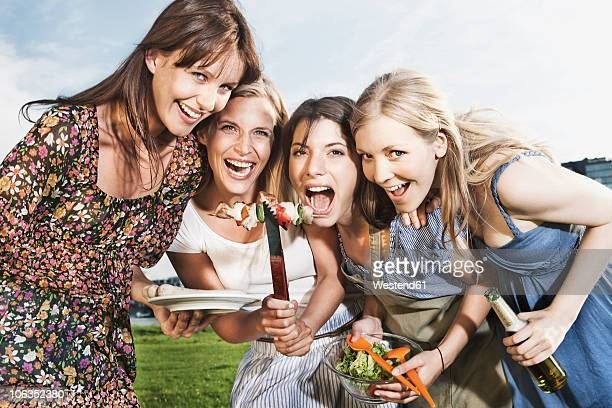 Germany, Cologne, Women enjoying beer and sausages