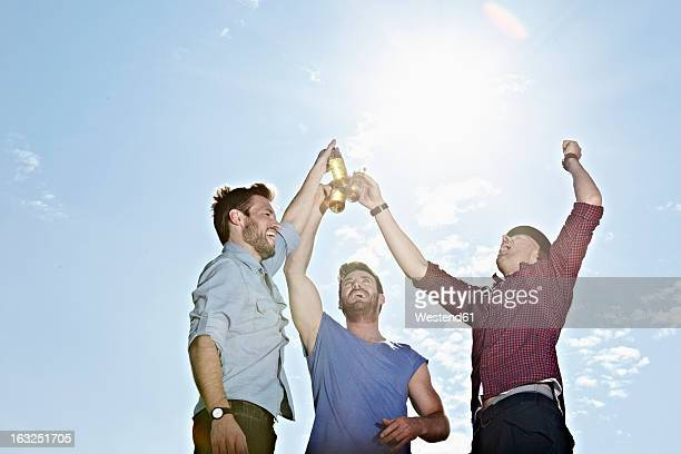 Germany, Cologne, Young men drinking beer
