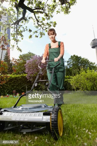 Woman Being Mowing Lawn With Lawnmower Stock Photo - Image