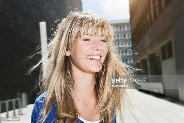Germany, Cologne, Young woman smiling, close up