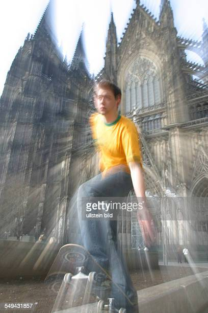 Youth in their free time A young man skateboarding in front of the cathedral in Cologne