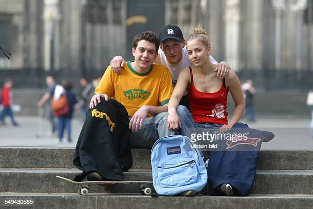 Youth in their free time Portraet of friends in front of the cathedral in Cologne