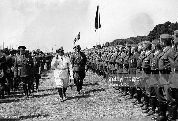 Germany CommanderinChief and leading Nazi politician Hermann Goering taking the salute of the Condor Legion after their return from Spain on a field...