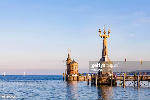 Germany, Constance, view to port entrance with lighthouse and Imperia