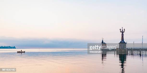 germany, constance, view to port entrance with lighthouse and imperia - baden württemberg stock pictures, royalty-free photos & images