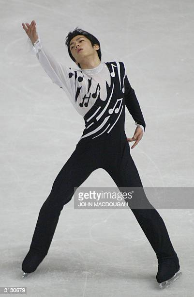 Daisuke Takahashi of Japan performs in the Mens Free Skating competition at the 2004 World Figure Skating Championships in Dortmund 25 March 2004 AFP...