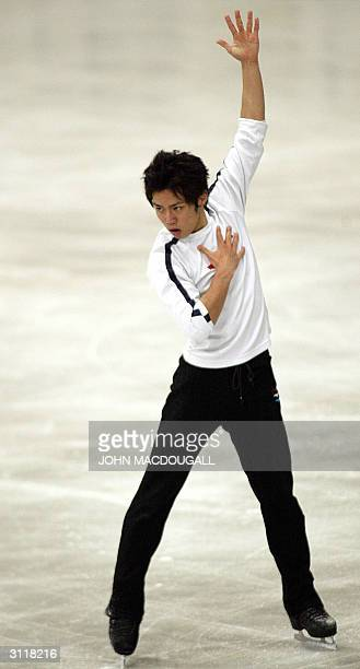 Daisuke Takahashi of Japan practices on the eve of the beginning of the 2004 World Figure Skating Championships in Dortmund 21 March 2004 AFP PHOTO...